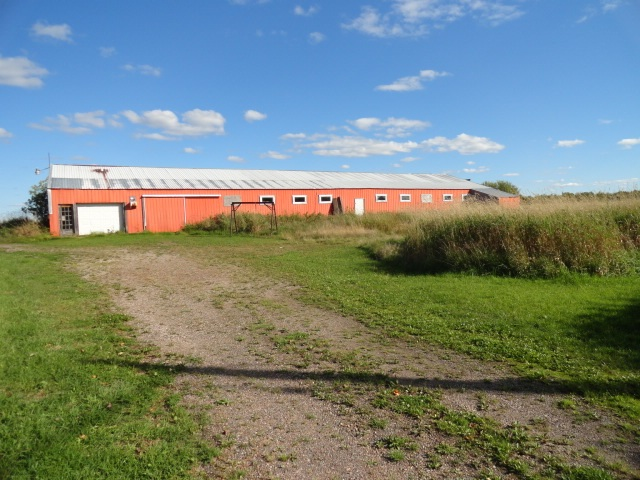 pole barn built into hill borseth properties serving the real estate and insurance needs of